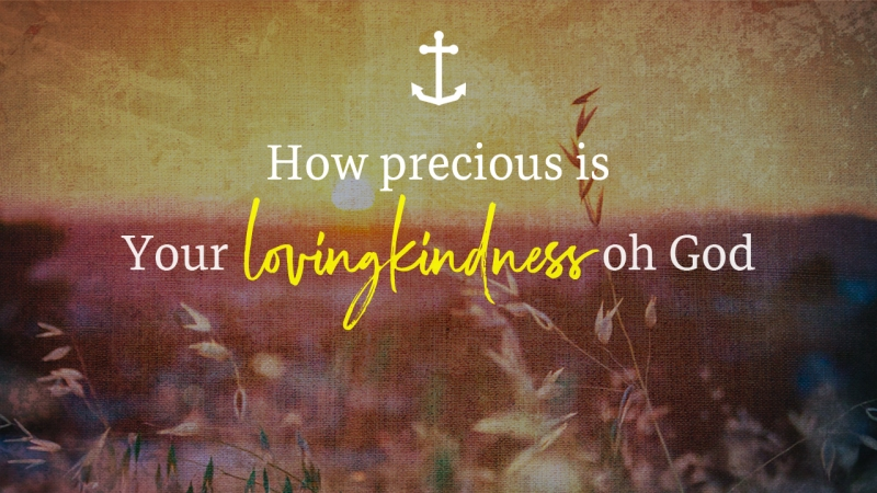 """Artistic image of grassy field with sun rising in background. Text from Psalm 36:7 reads, """"How precious is Your lovingkindness, oh God."""""""